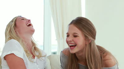 stock-footage-laughing-friends-talking-to-each-other-in-the-living-room
