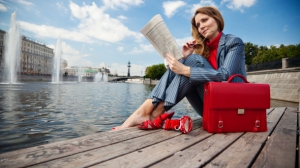 Woman-Entrepreneur-Relaxing-Reading-Newspaper