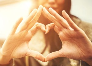 iStock_000033012016_woman-heart-hands_452x325px